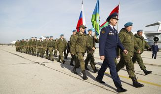 """In this Wednesday, Nov. 2, 2016, handout photo released by Ministry of Defence Republic of Serbia, Russian soldiers march after arrival at the military airport Batajnica, near Belgrade, Serbia, Wednesday, Nov. 2, 2016. The six-day armed drills in Serbia, dubbed """"The Slavic Brotherhood 2016,"""" began Thursday. They involve 212 Russian troops, 3 transport planes, 450 soldiers from Serbia and 56 from Belarus. (Zarko Skoko/Ministry of Defence Republic of Serbia via AP)"""