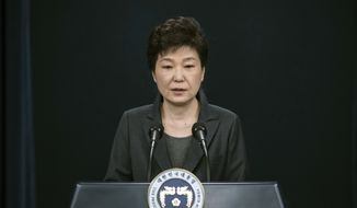 "South Korean President Park Geun-hye speaks during an address to the nation, at the presidential Blue House in Seoul Friday, Nov. 4, 2016. Park took sole blame Friday for a ""heartbreaking"" scandal that threatens her government and vowed she will accept a direct investigation into her actions amid rising suspicion that she allowed a mysterious confidante to manipulate power from the shadows. (Ed Jones/Pool Photo via AP)"