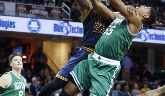 Cleveland Cavaliers' LeBron James (23) goes up to shoot against Boston Celtics' Jordan Mickey (55) during the second half of an NBA basketball game Thursday, Nov. 3, 2016, in Cleveland.  (AP Photo/Ron Schwane)