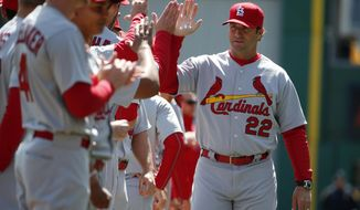 FILE - In this April 3, 2016, file photo, St. Louis Cardinals manager Mike Matheny (22) is introduced before a baseball game against the Pittsburgh Pirates in Pittsburgh. Cardinals manager Mike Matheny, whose team missed the playoffs in 2016 for the first time in his five-year tenure, has agreed to a three-year contract extension. The Cardinals announced the new contract Thursday, Nov. 3, 2016, a day after the rival Chicago Cubs won the World Series.  (AP Photo/Gene J. Puskar, File)
