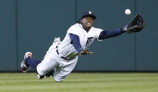 FILE - In this Sept. 13, 2016, file photo, Detroit Tigers center fielder Cameron Maybin dives to catch a fly ball by Minnesota Twins' Eduardo Escobar during a baseball game in Detroit. The Los Angeles Angels have acquired Maybin from the Tigers in a trade for right-hander Victor Alcantara. (AP Photo/Paul Sancya, File)
