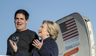 Democratic presidential candidate Hillary Clinton, accompanied by Dallas Mavericks basketball team owner Mark Cuban, arrives at Detroit Metropolitan Airport in Detroit, Friday, Nov. 4, 2016, to attend a rally. (AP Photo/Andrew Harnik)