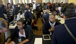 Job seekers attend the New York Department of Citywide Administrative Services (DCAS) 2016 job fair, Wednesday Nov. 2, 2016, in New York. U.S. employers added solid 161,000 jobs in October 2016, as unemployment rate fell to 4.9 percent.(AP Photo/Bebeto Matthews)