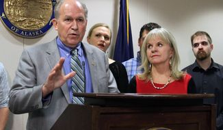 Alaska Gov. Bill Walker, left, appears at a news conference with his wife, Donna, and other family members on Friday, Nov. 4, 2016, in Anchorage, Alaska. Walker announced that he has a treatable form of prostate cancer, but said it will not prevent him from performing his duties as governor. (AP Photo/Mark Thiessen)
