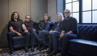 "In this Oct. 19, 2016 photo, members of Bon Jovi from left, Phil X, Tico Torres, Jon Bon Jovi, David Bryan and Hugh McDonald pose for a portrait in promotion of their new album ""This House is Not for Sale"" at the Sixty SoHo Hotel  in New York. (Photo by Drew Gurian/Invision/AP)"