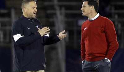 CORRECTS TO EAST HARTFORD NOT HARTFORD - Temple head coach Matt Rhule, left, talks with Connecticut head coach Bob Diaco prior to an NCAA college football game, Friday, Nov. 4, 2016, in East Hartford, Conn. (AP Photo/Elise Amendola)