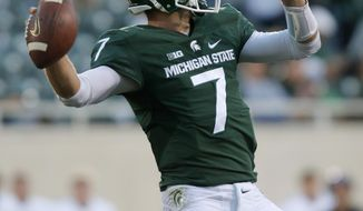 FILE - In this Oct. 15, 2016, file photo, Michigan State quarterback Tyler O'Connor throws a pass against Northwestern during the fourth quarter of an NCAA college football game, in East Lansing, Mich. Looking at the schedule back in August, Michigan State-Illinois was not a game many people would have guessed would pit a pair of 2-6 teams against each other.  (AP Photo/Al Goldis, File)
