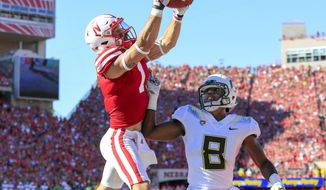 FILE - In this Sept. 17, 2016, file photo, Nebraska wide receiver Jordan Westerkamp (1) catches a touchdown pass over Oregon defensive back Reggie Daniels (8) during the first half of an NCAA college football game in Lincoln, Neb. Westerkamp said it gives Nebraska players extra confidence knowing that Ohio State was upset by Penn State and struggled until the last drive before defeating Northwestern. (AP Photo/Nati Harnik, File)