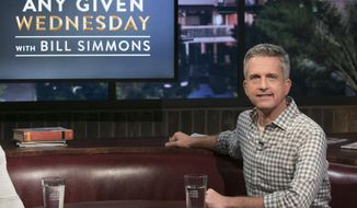 "This image released by HBO shows Bill Simmons on the set of ""Any Given Wednesday with Bill Simmons."" HBO canceled the weekly talk show is ending its run after less than five months. The last episode will air on Nov. 9. (Jordin Althaus/HBO via AP)"