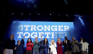 From left, Sen. Cory Booker, D-N.J.; former U.S. Secretary of State Madeleine Albright; actress Debra Messing; Sen. Bob Casey, Jr., D-Pa.; musician Katy Perry; Democratic presidential candidate Hillary Clinton; candidate for U.S. Senate Katie McGinty; candidate for U.S House of Representative; Dwight Evans, Rep. Bob Brady, D-Pa., and television producer Shonda Rhimes appear on stage during a Get Out the Vote concert at the Mann Center for the Performing Arts in Philadelphia, Saturday, Nov. 5, 2016. (AP Photo/Andrew Harnik)
