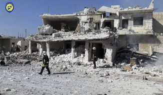 This photo provided by the Syrian Civil Defense White Helmets, which has been authenticated based on its contents and other AP reporting, shows Civil Defense workers walk past damaged buildings after airstrikes hit in Abian Saman town, in rural western Aleppo province, Syria, Saturday, Nov. 5, 2016. Despite a halt in airstrikes in eastern Aleppo city, there has been an intense aerial bombing campaign in the western Aleppo countryside and nearby Idlib province. Rebels say the strikes are an attempt to sever the supply lines of the rebels, waging an offensive on government-held western Aleppo. (Syrian Civil Defense White Helmets via AP)