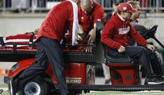 Nebraska quarterback Tommy Armstrong is carted off the field after being injured during the first half of the team's NCAA college football game against Ohio State on Saturday, Nov. 5, 2016, in Columbus, Ohio. (AP Photo/Jay LaPrete)