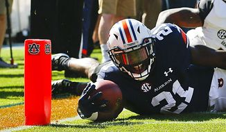 Auburn running back Kerryon Johnson dives over the goal line for a touchdown against Vanderbilt during the first half of an NCAA college football game, Saturday, Nov. 5, 2016, in Auburn, Ala. (AP Photo/Brynn Anderson)