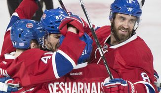 CORRECTS DATE Montreal Canadiens' Greg Pateryn, right, celebrates with teammates after scoring against the Philadelphia Flyers during first period NHL hockey action in Montreal, Saturday, Nov. 5, 2016. (Graham Hughes/The Canadian Press via AP)