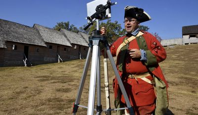 In this Nov. 1, 2016 photo, Fort Loudoun State Historic park manager Eric Hughey teaches a class to Colorado students via Skype in Vonore, Tenn. Hughey and the three rangers stationed at the park are taking part in a program run in cooperation with Microsoft's Skype that allows instructors to beam their lessons live to any corner of the world. (Michael Patrick/Knoxville News Sentinel via AP)