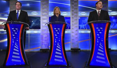 FILE - In this Nov. 3, 2016 file photo, Independent candidate Shawn O'Connor, left, Democratic candidate Carol Shea-Porter, center, and Republican incumbent Frank Guinta, prepare to debate in the 1st congressional debate  at the New Hampshire Institute of Politics at Saint Anselm College in Goffstown, N.H. (Thomas Roy/The Union Leader via AP)
