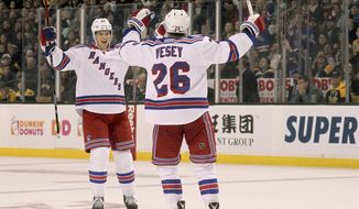 New York Rangers' Nick Holden, left, celebrates with teammate Jimmy Vesey (26) after scoring during the first period of an NHL hockey game against the Boston Bruins, Saturday, Nov. 5, 2016, in Boston. (AP Photo/Mary Schwalm)