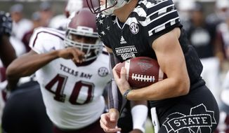 Mississippi State quarterback Nick Fitzgerald (7) runs past a Texas A&M defender for a 74-yard touchdown run in the first half of a NCAA college football game in Starkville, Miss., Saturday, Nov. 5, 2016. (AP Photo/Rogelio V. Solis)