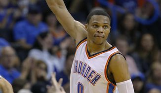 Oklahoma City Thunder guard Russell Westbrook gestures after scoring against the Minnesota Timberwolves during the first half of an NBA basketball game in Oklahoma City, Saturday, Nov. 5, 2016. (AP Photo/Alonzo Adams)
