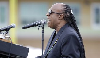 Musician Stevie Wonder performs at a campaign rally for Democratic presidential candidate Hillary Clinton before President Barack Obama spoke to the audience, Sunday, Nov. 6, 2016, in Kissimmee, Fla. (AP Photo/John Raoux)
