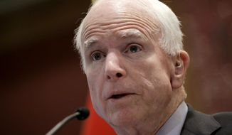 Sen. John McCain, Arizona Republican, frequently reminds voters that his Democratic opponent, Rep. Ann Kirkpatrick, voted for Obamacare in 2010, as Arizonans see their premiums spike by an average of 116 percent. (Associated Press)