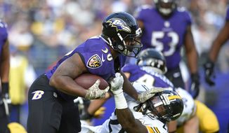 Baltimore Ravens running back Kenneth Dixon, left, tries to outrun Pittsburgh Steelers strong safety Robert Golden in the first half of an NFL football game, Sunday, Nov. 6, 2016, in Baltimore. (AP Photo/Nick Wass)