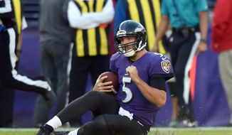 Baltimore Ravens quarterback Joe Flacco slides into the turf as he rushes the ball in the second half of an NFL football game against the Pittsburgh Steelers, Sunday, Nov. 6, 2016, in Baltimore. Flacco briefly left the game after the play. (AP Photo/Gail Burton)