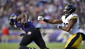 Baltimore Ravens wide receiver Mike Wallace, left, breaks free from Pittsburgh Steelers free safety Mike Mitchell for a touchdown in the first half of an NFL football game, Sunday, Nov. 6, 2016, in Baltimore. (AP Photo/Nick Wass)