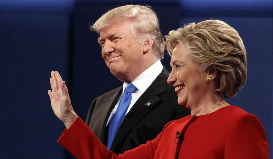 Donald Trump stands with Hillary Clinton at the first presidential debate on Sept. 26, 2016, at Hofstra University in Hempstead, New York. (Associated Press) ** FILE **