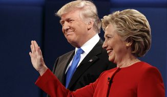 Donald Trump stands with Hillary Clinton at the first presidential debate on Sept. 26 at Hofstra University in Hempstead, New York. (Associated Press)