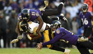 Pittsburgh Steelers wide receiver Antonio Brown (84) is tackled by Baltimore Ravens free safety Lardarius Webb (21) and strong safety Eric Weddle while rushing the ball in the second half of an NFL football game, Sunday, Nov. 6, 2016, in Baltimore. (AP Photo/Gail Burton)