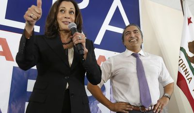 In this Nov. 3, 2016, photo, Democratic U.S. Senate candidate, Attorney General Kamala Harris gives a thumbs up to supporters during her visit to the campaign office of Rep. Ami Bera, D-Calif., in Elk Grove, Calif. (AP Photo/Rich Pedroncelli)