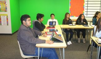 In this October 2016 photo Kearney Hub Gibbon High School students share their experiences and learn from each other as they prepare to be the first generation of their family to attend college, in Gibbon, Neb. From left are seniors Pedro Nunez, Mauricio Martinez and Edhel Escandon; and sophomores Jessica Tamayo, Michelle Guido and Avigail Corona. (Peggy Michael-Rush/The Daily Hub via AP)