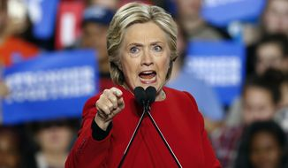 Polls in the final two weeks of the campaign show female voters favoring Hillary Clinton anywhere from 10 to 17 percentage points over Republican nominee Donald Trump. (Associated Press)