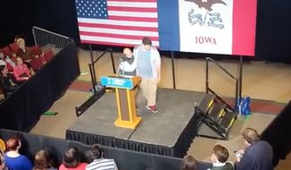 Kaleb Vanfosson, an Iowa State University student, was escorted off the stage at a rally for Hillary Clinton on Saturday after he used his speech to criticize the Democratic presidential nominee. (YouTube/@David K)