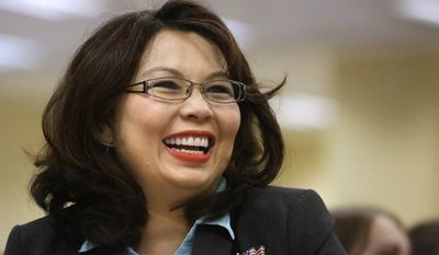 FILE - In this Aug. 13, 2014, file photo, Illinois Democratic U.S. Senate candidate, Rep. Tammy Duckworth, appears in Springfield, Ill. (AP Photo/Seth Perlman, File)