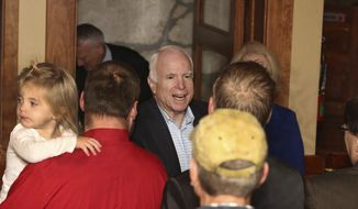Sen. John McCain, center, greets supporters Monday, Nov. 7 2016, during a campaign stop in Flagstaff, Ariz. (Jake Bacon/Arizona Daily Sun via AP)