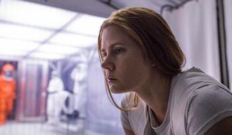 "This image released by Paramount Pictures shows Amy Adams in a scene from ""Arrival."" (Jan Thijs/Paramount Pictures via AP)"