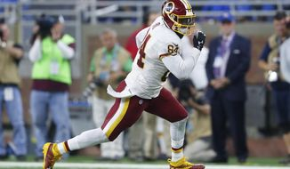 In this photo taken Oct. 24, 2016, Washington Redskins tight end Niles Paul (84) runs after a catch Detroit Lions during an NFL football game in Detroit. The Washington Redskins have placed tight end Niles Paul on injured reserve with a shoulder injury. Coach Jay Gruden made the announcement Monday, Nov. 7, 2016, as the Redskins returned to practice after their bye week. Gruden says Paul will need surgery to repair his injured labrum.  (AP Photo/Paul Sancya)