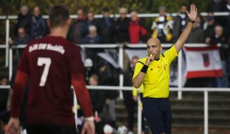In this photo taken Sunday, Nov. 6, 2016, soccer referee Ammar Sahar, right, a 27-year-old refugee from Syria directs a match of the amateur soccer league Berlin Liga in Berlin, Germany. Almost one year into his new life in Germany, Syrian refugee Sahar is well on his way to realizing his dream of becoming a Bundesliga referee. (AP Photo/Markus Schreiber).