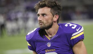 FILE - In this Oct. 3, 2016, file photo, Minnesota Vikings kicker Blair Walsh walks on the sidelines during the first half of an NFL football game against the New York Giants, in Minneapolis. Walsh has not bounced back from the devastating 27-yard miss that kept Minnesota from winning a playoff game last season. For the first time this season, his struggles directly cost the Vikings a victory, with a missed extra point and a blocked field goal in a game that was lost in overtime. (AP Photo/Andy Clayton-King, File)