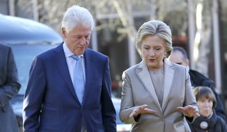 Democratic presidential candidate Hillary Clinton and her husband former President Bill Clinton talk after voting in Chappaqua, N.Y., Tuesday, Nov. 8, 2016. (AP Photo/Seth Wenig)