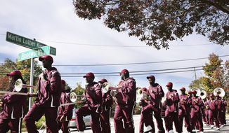 The Shaw University band leads students on a march to the polls at Chavis Park in Raleigh, NC., on Tuesday, Nov. 8, 2016. (Juli Leonard/The News & Observer via AP)