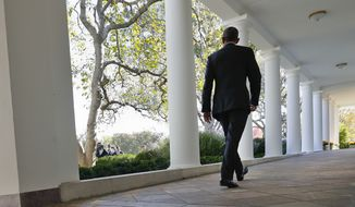 President Barack Obama walks down the White House Colonnade from the main residence to the Oval Office, Tuesday, Nov. 8, 2016, in Washington. (AP Photo/Pablo Martinez Monsivais)