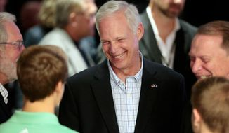 U.S. Sen. Ron Johnson, R-Wis., visits with supporters at his Election Night party at the Oshkosh Convention Center in Oshkosh, Wis., Tuesday, Nov. 8, 2016. (Michael P. King/Wisconsin State Journal via AP)