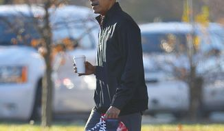 President Barack Obama, wearing his Chicago White Sox baseball cap, and carrying a pair of sneakers, arrives for a private game of basketball at Fort McNair in Washington, Tuesday, Nov. 8, 2016. Playing basketball on election day is a tradition for Obama. (AP Photo/Pablo Martinez Monsivais)