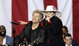 Jon Bon Jovi and Lady Gaga perform during a campaign rally for Democratic presidential candidate Hillary Clinton in Raleigh, N.C., Tuesday, Nov. 8, 2016. (AP Photo/Gerry Broome)