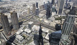 A general view of Dubai is shown from the Burj Khalifa tower, the world's tallest building, in Dubai, United Arab Emirates, Tuesday, Nov. 8, 2016. The futuristic city-state of Dubai announced a deal on Tuesday with Los Angeles-based Hyperloop One to study the potential for building a line linking it to the Emirati capital of Abu Dhabi. (AP Photo/Jon Gambrell) ** FILE **