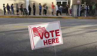 Voters line up at the Coral Ridge Mall, Tuesday, Nov. 8, 2016, at polling stations in Fort Lauderdale, Fla. (Joe Cavaretta/South Florida Sun-Sentinel via AP)