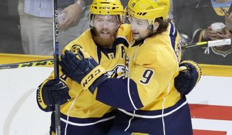 Nashville Predators defenseman Ryan Ellis (4) celebrates with left wing Filip Forsberg (9), of Sweden, after Ellis scored against the Ottawa Senators during the third period of an NHL hockey game Tuesday, Nov. 8, 2016, in Nashville, Tenn. The Predators won 3-1. (AP Photo/Mark Humphrey)